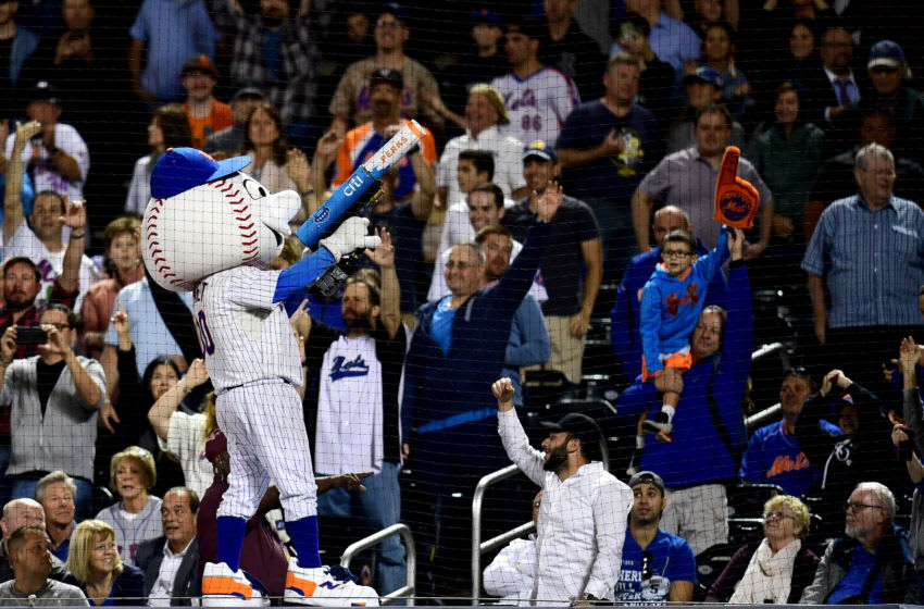 NEW YORK, NEW YORK - SEPTEMBER 24: Fans cheer as Mr. Met throws tee shirts during the New York Mets and Miami Marlins game at Citi Field on September 24, 2019 in the Flushing neighborhood of the Queens borough of New York City. (Photo by Emilee Chinn/Getty Images)