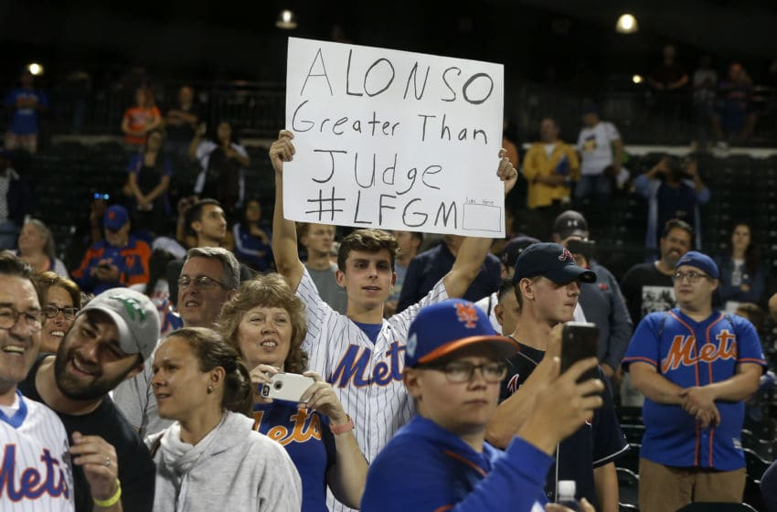NEW YORK, NEW YORK - SEPTEMBER 28: A fan holds a banner after a game between the New York Mets and the Atlanta Braves in reference to the Mets' Pete Alonso breaking the rookie home run record previously held by Aaron Judge of the New York Yankees at Citi Field on September 28, 2019 in New York City. The Mets defeated the Braves 3-0. (Photo by Jim McIsaac/Getty Images)