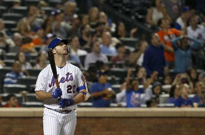 NEW YORK, NEW YORK - SEPTEMBER 28: Pete Alonso #20 of the New York Mets follows through on his third inning home run against the Atlanta Braves at Citi Field on September 28, 2019 in New York City. The Mets defeated the Braves 3-0. The home run was Alonso's 53rd of the season setting a new rookie record. (Photo by Jim McIsaac/Getty Images)