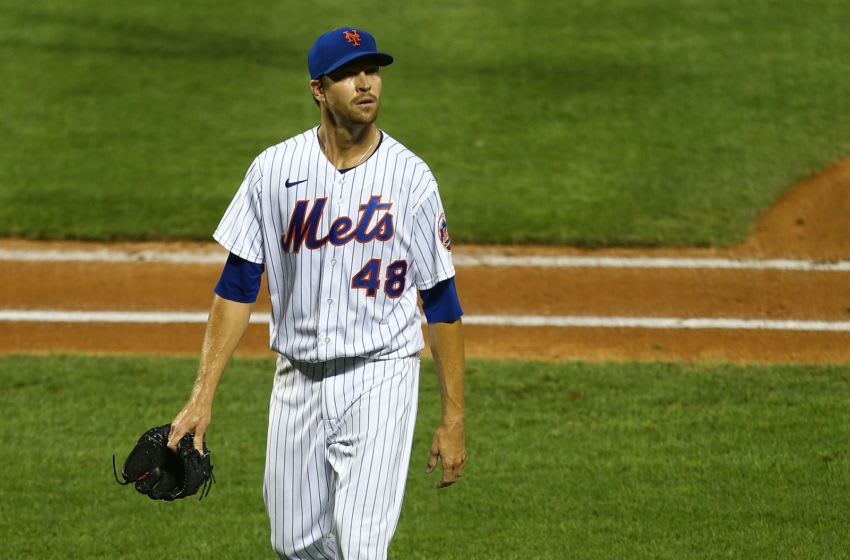 NEW YORK, NEW YORK - JULY 29: Jacob deGrom #48 of the New York Mets reacts after the third out of the fourth inning against the Boston Red Sox at Citi Field on July 29, 2020 in New York City. (Photo by Mike Stobe/Getty Images)