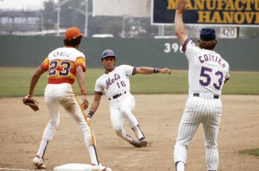 NEW YORK - CIRCA 1979: Lee Mazzilli #16 of the New York Mets slides into third base as Enos Cabell #23 of the Houston Astros looks on during an Major League Baseball game circa 1979 at Shea Stadium in the Queens borough of New York City. Mazzilli played for the Mets from 1976-82. (Photo by Focus on Sport/Getty Images)