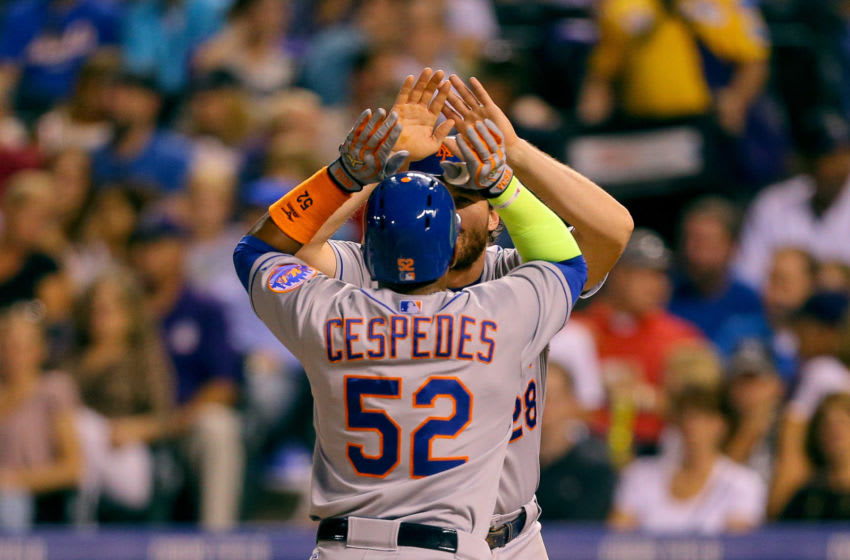 DENVER, CO - AUGUST 21: Yoenis Cespedes #52 of the New York Mets is congratulated by Daniel Murphy #28 after hitting his third home run of the game, a three run shot, during the sixth inning against the Colorado Rockies at Coors Field on August 21, 2015 in Denver, Colorado. (Photo by Justin Edmonds/Getty Images)