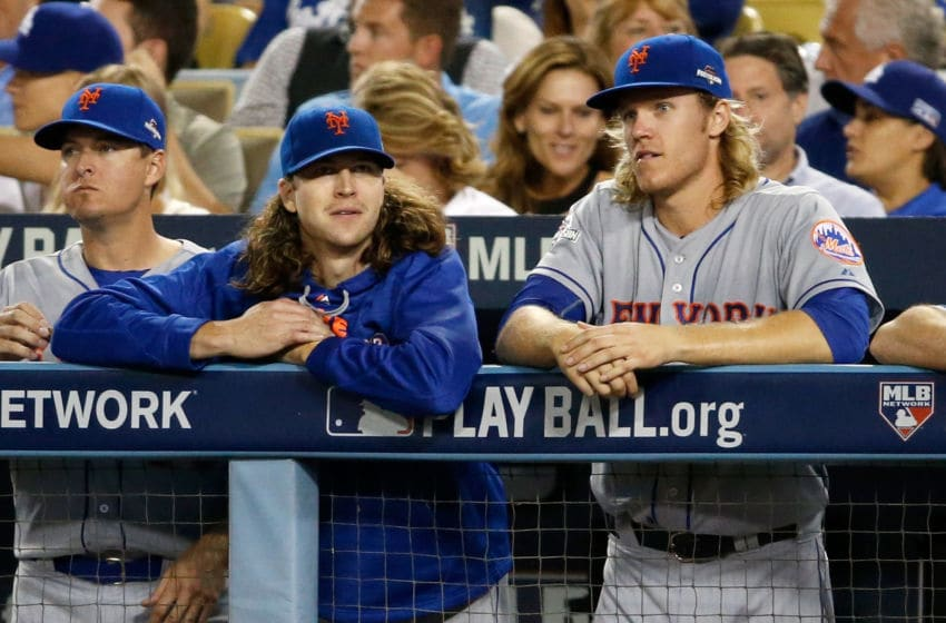 LOS ANGELES, CA - OCTOBER 15: Jacob deGrom #48 and Noah Syndergaard #34 of the New York Mets watch from the dugout in the eighth inning against the Los Angeles Dodgers in game five of the National League Division Series at Dodger Stadium on October 15, 2015 in Los Angeles, California. (Photo by Sean M. Haffey/Getty Images)