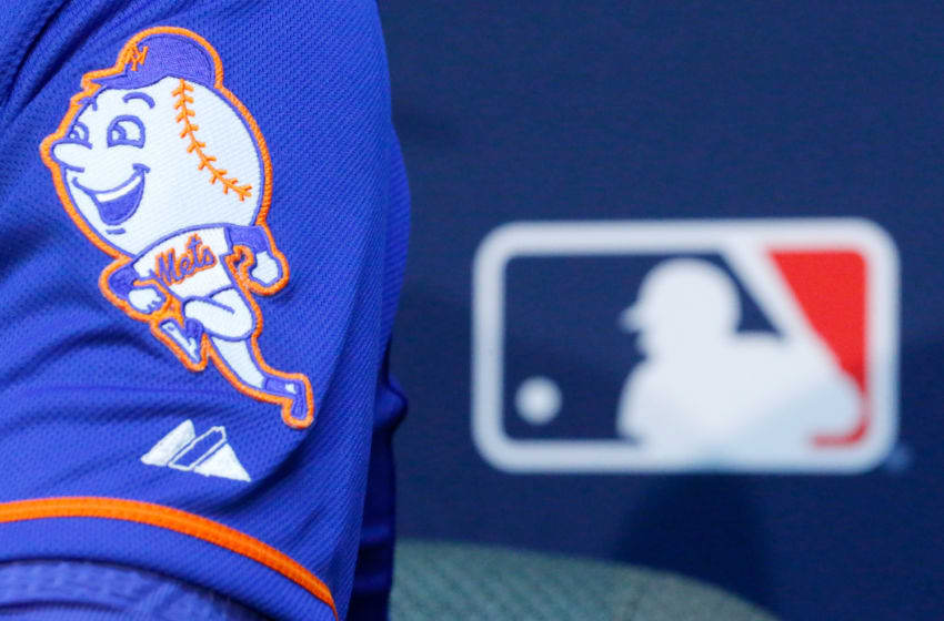 KANSAS CITY, MO - OCTOBER 26: The New York Mets logo is seen on the sleeve of Matt Harvey #33 as he addresses the media the day before Game 1 of the 2015 World Series between the Royals and Mets at Kauffman Stadium on October 26, 2015 in Kansas City, Missouri. (Photo by Kyle Rivas/Getty Images)