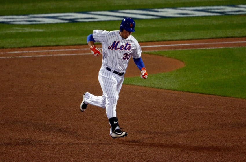 NEW YORK, NY - OCTOBER 31: Michael Conforto #30 of the New York Mets rounds the bases after hitting a solo home run in the fifth inning against Danny Duffy #41 of the Kansas City Royals during Game Four of the 2015 World Series at Citi Field on October 31, 2015 in the Flushing neighborhood of the Queens borough of New York City. (Photo by Mike Stobe/Getty Images)