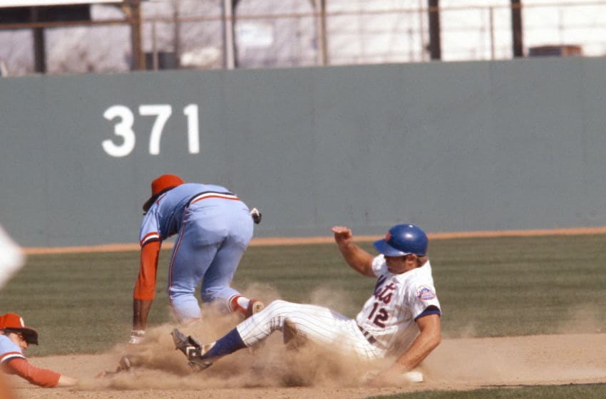 NEW YORK - CIRCA 1978: John Stearns #12 of the New York Mets slides into second base against the St. Louis Cardinals during an Major League Baseball game circa 1978 at Shea Stadium in the Queens borough of New York City. Stearns played for the Mets from 1975-84. (Photo by Focus on Sport/Getty Images)