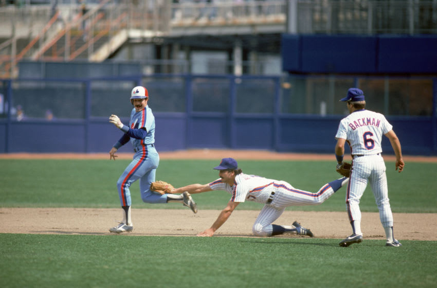 FLUSHING, NY - 1984: Keith Hernandez #17 of the New York Mets reaches and tags out the runner during a 1984 season game against the Montreal Expos at Shea Stadium in Flushing, New York. (Photo by Rich Pilling/MLB Photos via Getty Images)
