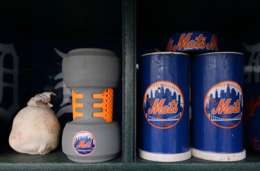 DETROIT, MICHIGAN - AUGUST 05: A detailed view of New York Mets baseball bat weights and rosin bag sitting in the dugout prior to the game against the Detroit Tigers at Comerica Park on August 5, 2016 in Detroit, Michigan. The Tigers defeated the Mets 4-3. (Photo by Mark Cunningham/MLB Photos via Getty Images)
