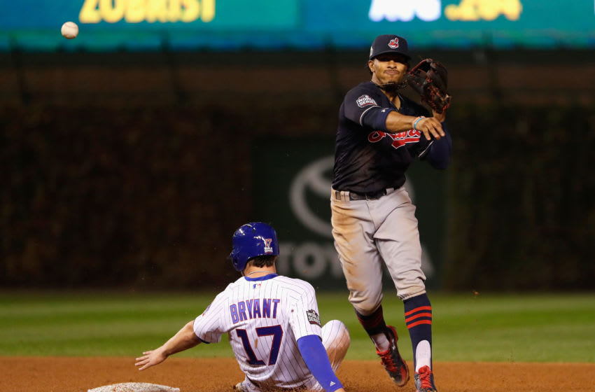 CHICAGO, IL - OCTOBER 28: Francisco Lindor #12 of the Cleveland Indians forces out Kris Bryant #17 of the Chicago Cubs at second base in the fourth inning in Game Three of the 2016 World Series at Wrigley Field on October 28, 2016 in Chicago, Illinois. (Photo by Jamie Squire/Getty Images)