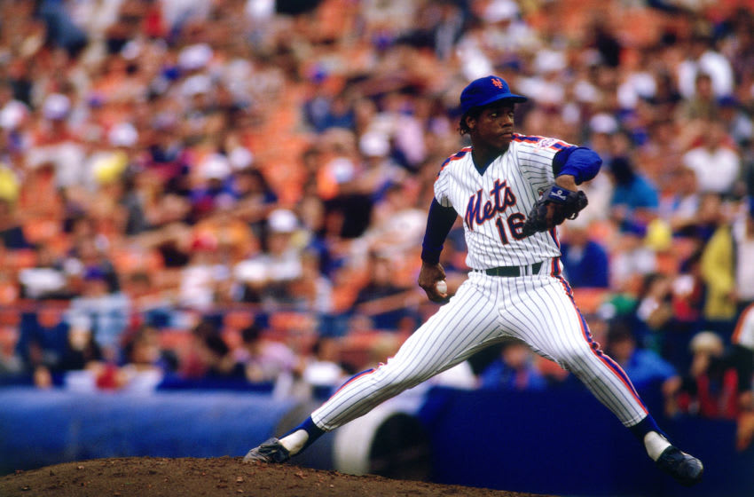 FLUSHING- OCTOBER 1986 : Dwight Gooden #16 of the New York Mets pitching to the Houston Astros during a League Championship Game on October 14. 1986 at Shea Stadium in Flushing, New York. The Mets defeated the Astros 2-1. (Photo by Ronald C. Modra/Getty Images)