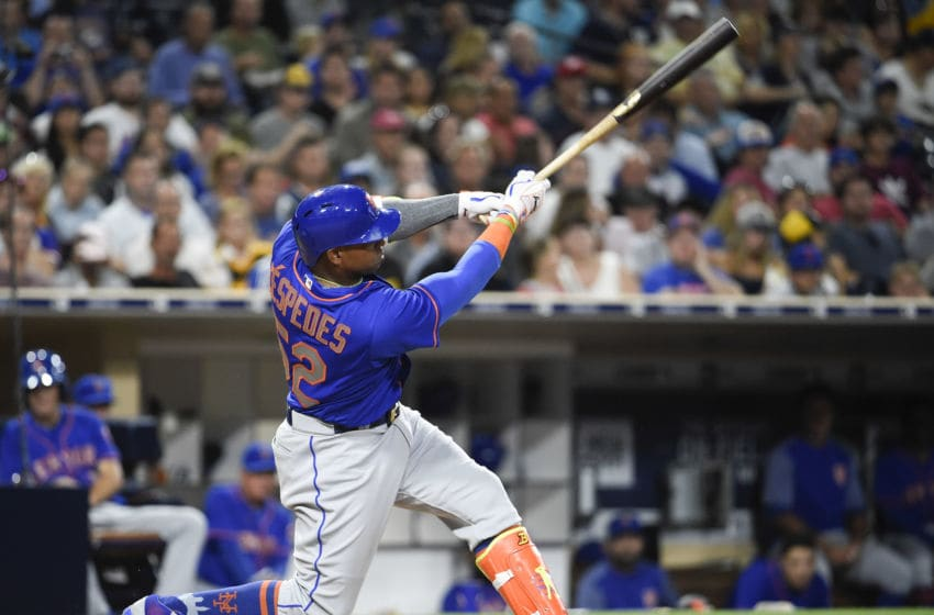 SAN DIEGO, CA - JULY 27: Yoenis Cespedes #52 of the New York Mets hits an RBI double during the seventh inning of a baseball game against the San Diego Padres at PETCO Park on July 27, 2017 in San Diego, California. (Photo by Denis Poroy/Getty Images)