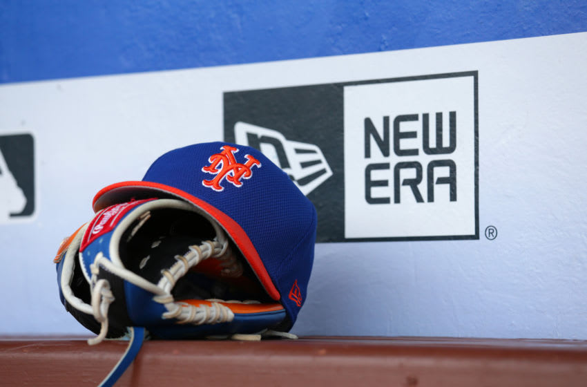 PHILADELPHIA, PA - AUGUST 12: A baseball hat and a glove sit on the bench in the dugout before a game between the New York Mets and the Philadelphia Phillies at Citizens Bank Park on August 12, 2017 in Philadelphia, Pennsylvania. The Phillies won 3-1. (Photo by Hunter Martin/Getty Images) *** Local Caption ***