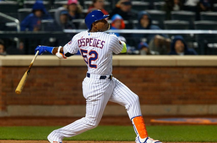 NEW YORK, NY - APRIL 14: Yoenis Cespedes #52 of the New York Mets follows through on a sixth inning RBI single against the Milwaukee Brewers at Citi Field on April 14, 2018 in the Flushing neighborhood of the Queens borough of New York City. (Photo by Jim McIsaac/Getty Images)