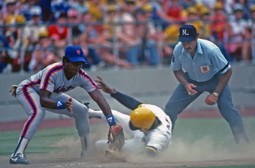 PITTSBURGH, PA - 1982: Hubie Brooks (L) of the New York Mets tags Lee Lacey of the Pittsburgh Pirates as Lacey slides into third base as umpire Dick Stello looks on during a Major League Baseball game at Three Rivers Stadium in 1982 in Pittsburgh, Pennsylvania. (Photo by George Gojkovich/Getty Images)