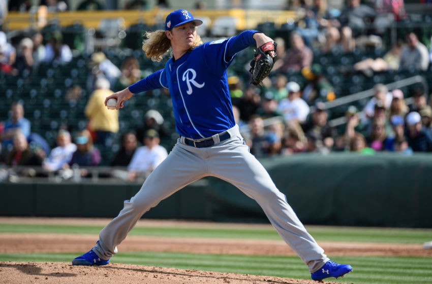 MESA, ARIZONA - FEBRUARY 24: Sam McWilliams #52 of the Kansas City Royals delivers a pitch during the spring training game against the Oakland Athletics at HoHoKam Stadium on February 24, 2019 in Mesa, Arizona. (Photo by Jennifer Stewart/Getty Images)
