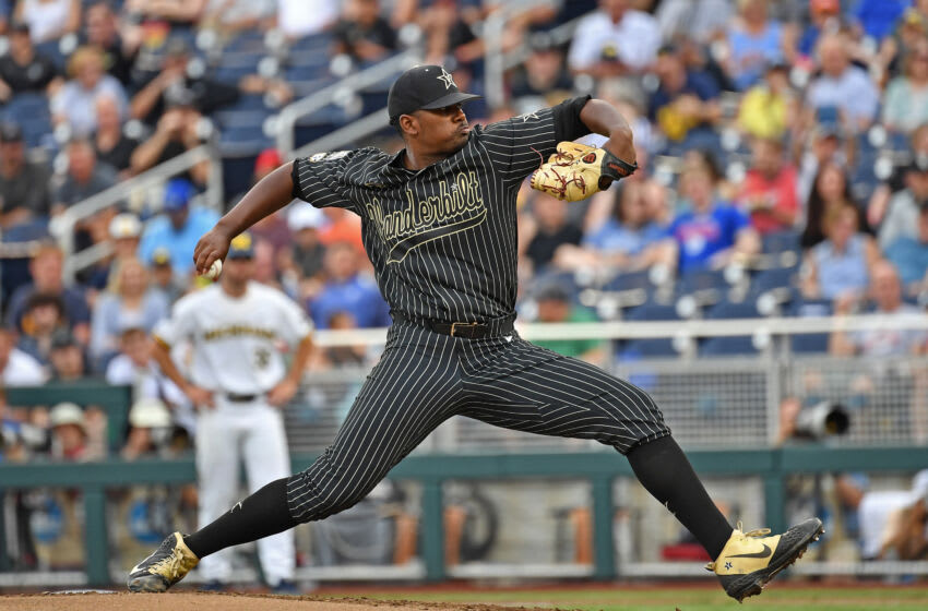 OMAHA, NE - JUNE 25: Pitcher Kumar Rocker #80 of the Vanderbilt Commodores delivers a pitch in the first inning against the Michigan Wolverines during game two of the College World Series Championship Series on June 25, 2019 at TD Ameritrade Park Omaha in Omaha, Nebraska. (Photo by Peter Aiken/Getty Images)