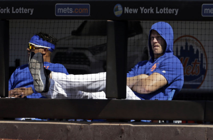NEW YORK, NY - AUGUST 25: Noah Syndergaard #34 of the New York Mets of the New York Mets looks on during the seventh inning against the Atlanta Braves at Citi Field on August 25, 2019 in the Flushing neighborhood of the Queens borough of New York City. Teams are wearing special color-schemed uniforms with players choosing nicknames to display for Players' Weekend. The Braves won 2-1. (Photo by Adam Hunger/Getty Images)
