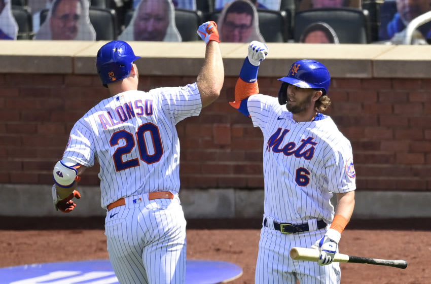NEW YORK, NEW YORK - SEPTEMBER 06: Pete Alonso #20 of the New York Mets is congratulated by his teammate Jeff McNeil #6 after hitting a solo home run against the Philadelphia Phillies during the second inning at Citi Field on September 06, 2020 in New York City. (Photo by Steven Ryan/Getty Images)