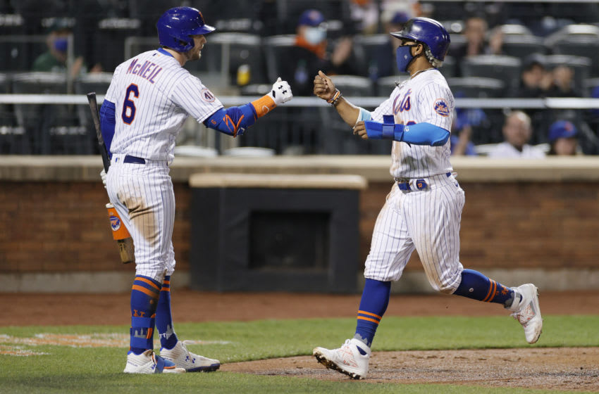 NEW YORK, NEW YORK - APRIL 14: Jeff McNeil #6 high-fives Francisco Lindor #12 of the New York Mets after he scored during the eighth inning against the Philadelphia Phillies at Citi Field on April 14, 2021 in the Queens borough of New York City. (Photo by Sarah Stier/Getty Images)