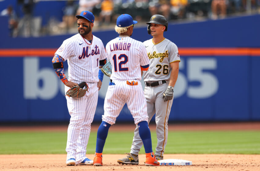 NEW YORK, NY - JULY 11: Jonathan Villar #1 and Francisco Lindor #12 of the New York Mets talk with Adam Frazier #26 of the Pittsburgh Pirates during a game at Citi Field on July 11, 2021 in New York City. (Photo by Rich Schultz/Getty Images)