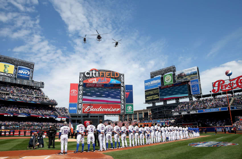NEW YORK, NY - APRIL 13: The New York Mets line up for the national anthem before the start of their Opening Day game against the Philadelphia Phillies on April 13, 2015 at Citi Field in the Flushing neighborhood of the Queens borough of New York City. (Photo by Elsa/Getty Images)
