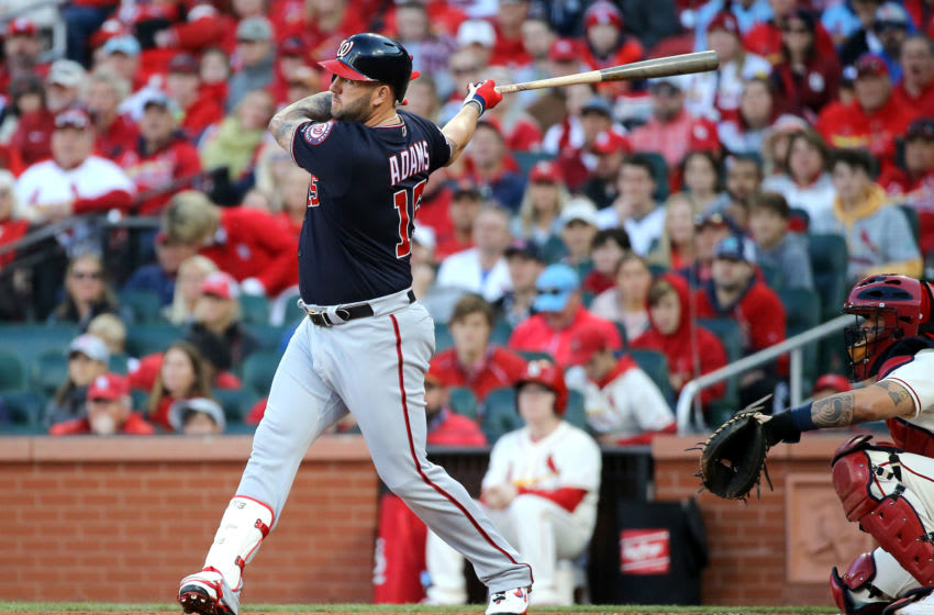 ST LOUIS, MISSOURI - OCTOBER 12: Matt Adams #15 of the Washington Nationals hits a single during the eighth inning of game two of the National League Championship Series against the St. Louis Cardinals at Busch Stadium on October 12, 2019 in St Louis, Missouri. (Photo by Scott Kane/Getty Images)