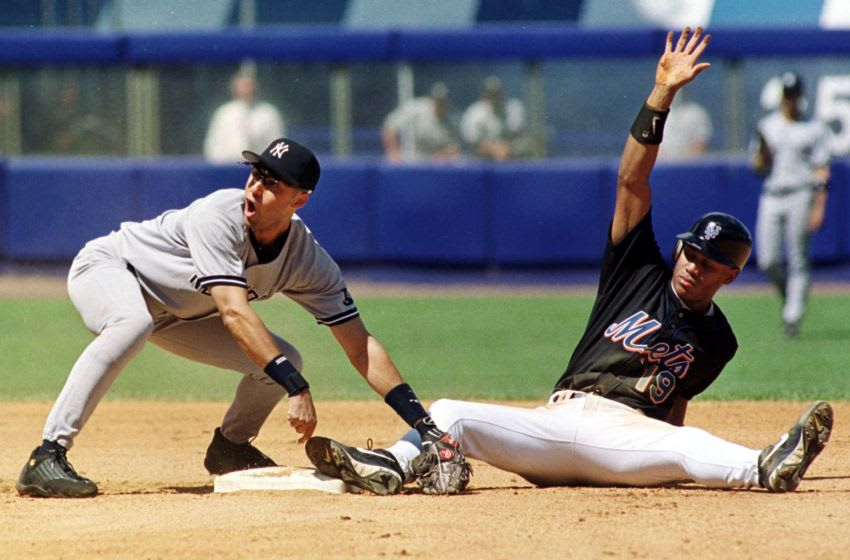 New York Yankees shortstop Derek Jeter (L) protests the call as New York Mets right fielder Roger Cedeno (R) calls for time after stealing second base in the bottom of the fourth inning 11 July, 1999, at Shea Stadium in Flushing. The Mets won the first two games of the three-game interleague series. AFP PHOTO/Matt CAMPBELL (Photo by MATT CAMPBELL / AFP) (Photo credit should read MATT CAMPBELL/AFP via Getty Images)