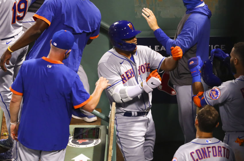 BOSTON, MA - JULY 27: Dominic Smith #2 of the New York Mets reacts as he returns to the dugout after hitting a three-run home run in the fourth inning of a game against the Boston Red Sox at Fenway Park on July 27, 2020 in Boston, Massachusetts. (Photo by Adam Glanzman/Getty Images)