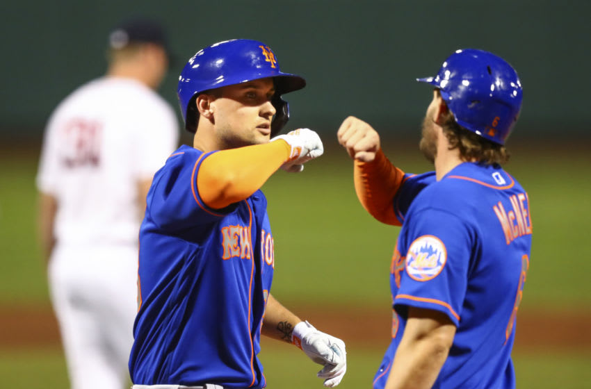 BOSTON, MA - JULY 28: J.D. Davis #28 high fives Jeff McNeil #6 of the New York Mets after hitting a two-run home run in the fifth inning of a game against the Boston Red Sox at Fenway Park on July 28, 2020 in Boston, Massachusetts. (Photo by Adam Glanzman/Getty Images)