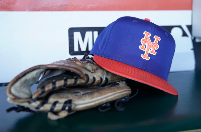 Aug 31, 2018; San Francisco, CA, USA; General view of the New York Mets baseball glove and cap before the game against the San Francisco Giants at AT&T Park. Mandatory Credit: Stan Szeto-USA TODAY Sports