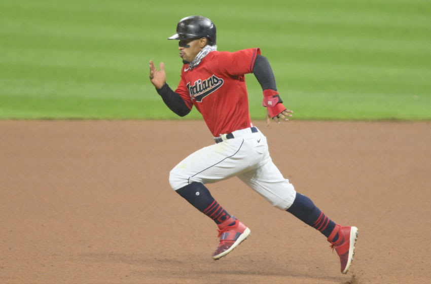 Sep 21, 2020; Cleveland, Ohio, USA; Cleveland Indians shortstop Francisco Lindor (12) runs to second base before being thrown out on an attempted steal in the seventh inning against the Chicago White Sox at Progressive Field. Mandatory Credit: David Richard-USA TODAY Sports