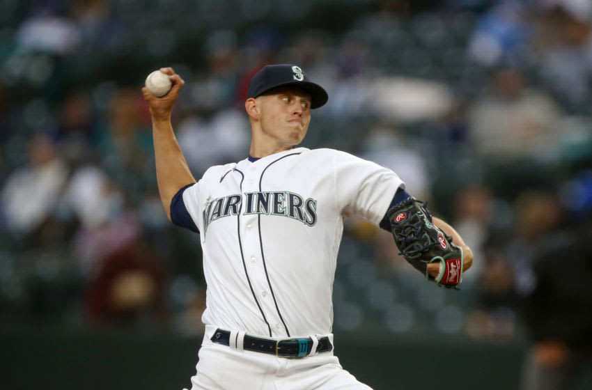Apr 3, 2021; Seattle, Washington, USA; Seattle Mariners starting pitcher Chris Flexen (77) throws against the San Francisco Giants during the second inning at T-Mobile Park. Mandatory Credit: Joe Nicholson-USA TODAY Sports