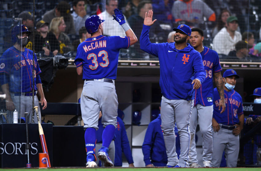 Jun 3, 2021; San Diego, California, USA; New York Mets catcher James McCann (33) is greeted at the dugout after hitting a two-run home run against the San Diego Padres during the sixth inning at Petco Park. Mandatory Credit: Orlando Ramirez-USA TODAY Sports