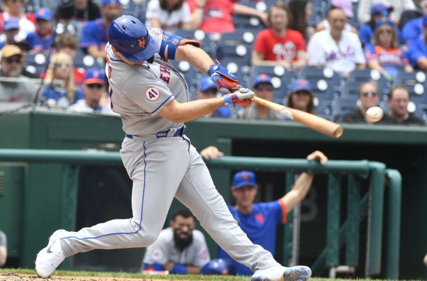 Jun 19, 2021; Washington, District of Columbia, USA; New York Mets first baseman Pete Alonso (20) hits a single against the Washington Nationals during the third inning at Nationals Park. Mandatory Credit: Brad Mills-USA TODAY Sports