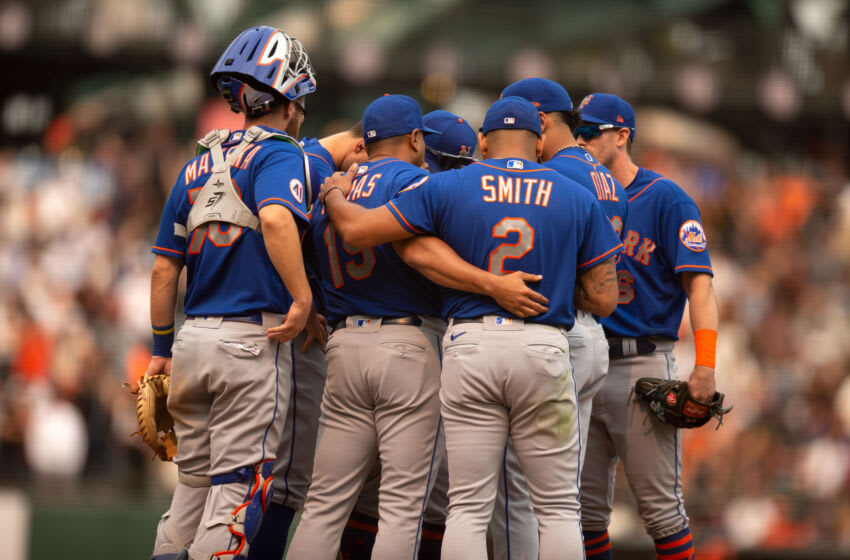 Aug 18, 2021; San Francisco, California, USA; New York Mets manager Luis Rojas (19) confers with his players during the tenth inning against the San Francisco Giants at Oracle Park. Mandatory Credit: D. Ross Cameron-USA TODAY Sports