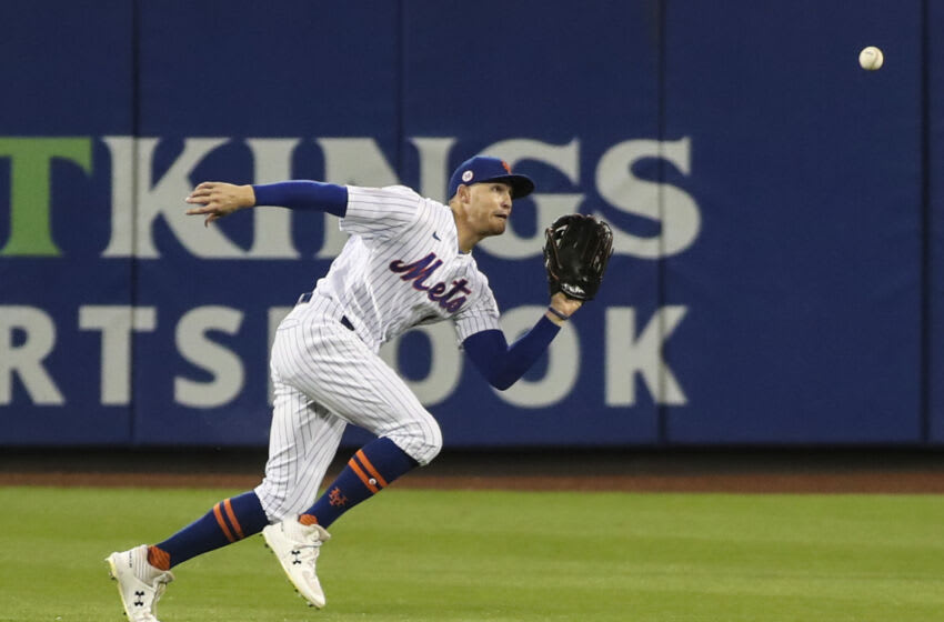 Aug 28, 2021; New York City, New York, USA; New York Mets center fielder Brandon Nimmo (9) makes a running catch for the third out in the first inning against the Washington Nationals at Citi Field. Mandatory Credit: Wendell Cruz-USA TODAY Sports