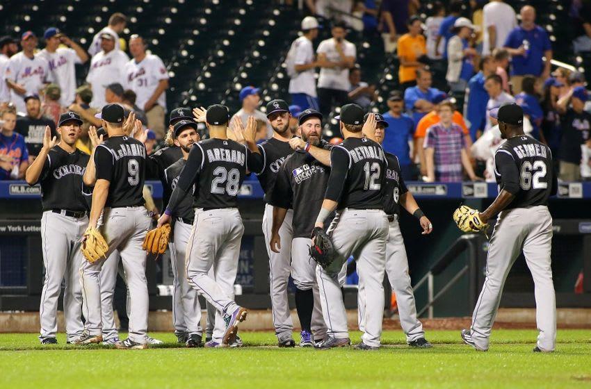 Jul 30, 2016; New York City, NY, USA; The Colorado Rockies celebrate after defeating the New York Mets 7-2 at Citi Field. The Rockies won 7-2. Mandatory Credit: Andy Marlin-USA TODAY Sports