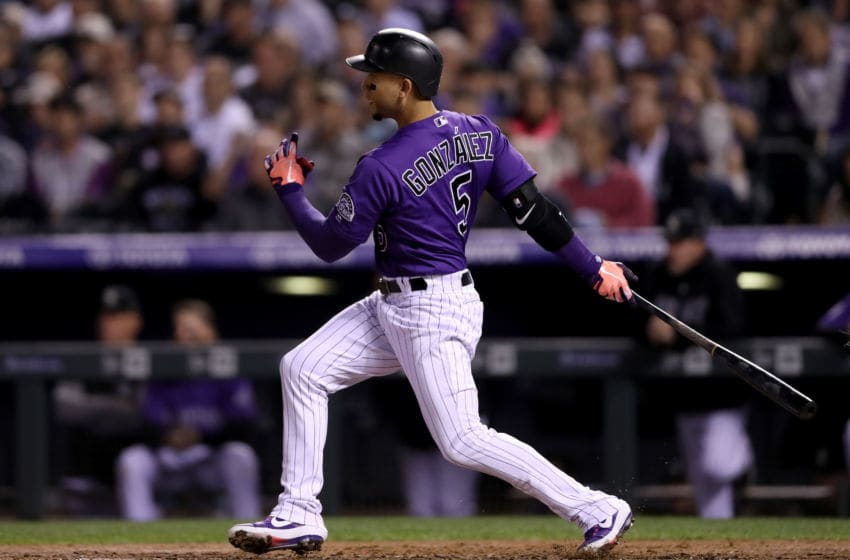DENVER, CO - SEPTEMBER 26: Carlos Gonzalez #5 of the Colorado Rockies hits a RBI single in the fourth inning against the Philadelphia Phillies at Coors Field on September 26, 2018 in Denver, Colorado. (Photo by Matthew Stockman/Getty Images)