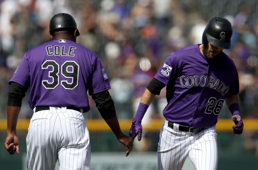 DENVER, CO - SEPTEMBER 27: David Dahl #26 of the Colorado Rockies is congraulated by third base coach Stu Cole #39 as he circles the bases after hitting a home run in the first inning against the Philadelphia Phillies at Coors Field on September 27, 2018 in Denver, Colorado. (Photo by Matthew Stockman/Getty Images)