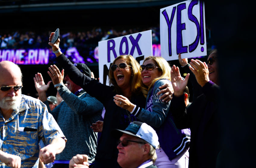DENVER, CO - SEPTEMBER 30: Colorado Rockies fans cheer after a first inning homerun by Nolan Arenado #28 of the Colorado Rockies during a game between the Colorado Rockies and the Washington Nationals at Coors Field on September 30, 2018 in Denver, Colorado. (Photo by Dustin Bradford/Getty Images)
