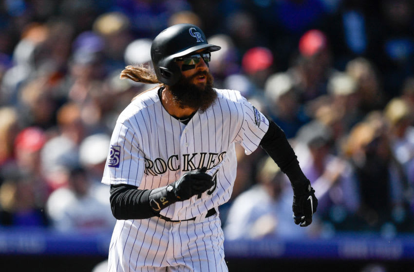 DENVER, CO - SEPTEMBER 30: Charlie Blackmon #19 of the Colorado Rockies watches the flight of a third inning two-run homerun against the Washington Nationals at Coors Field on September 30, 2018 in Denver, Colorado. (Photo by Dustin Bradford/Getty Images)