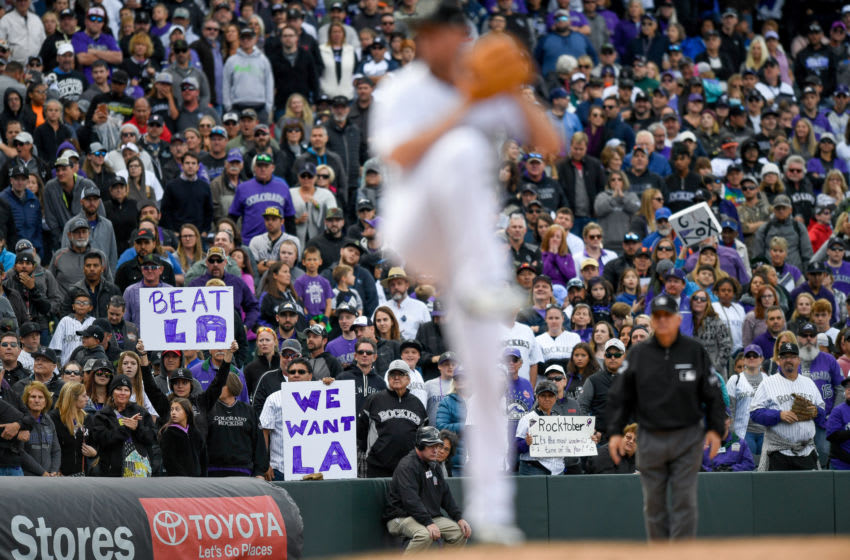DENVER, CO - SEPTEMBER 30: Colorado Rockies fans hold signs referring to the tiebreaker game with the Los Angeles Dodgers and with references to