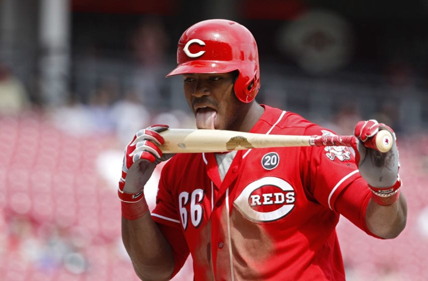 CINCINNATI, OH - APRIL 11: Yasiel Puig #66 of the Cincinnati Reds licks his bat after fouling off a pitch in the seventh inning against the Miami Marlins at Great American Ball Park on April 11, 2019 in Cincinnati, Ohio. The Reds won 5-0. (Photo by Joe Robbins/Getty Images)