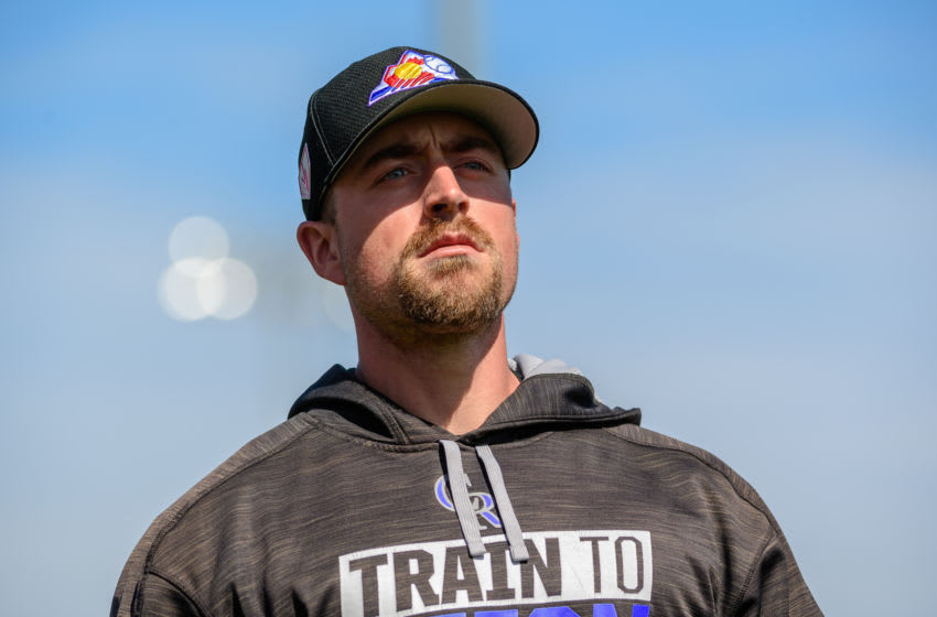 MESA, ARIZONA - MARCH 01: Tom Murphy #23 of the Colorado Rockies reacts during the spring training game against the Oakland Athletics at HoHoKam Stadium on March 01, 2019 in Mesa, Arizona. (Photo by Jennifer Stewart/Getty Images)