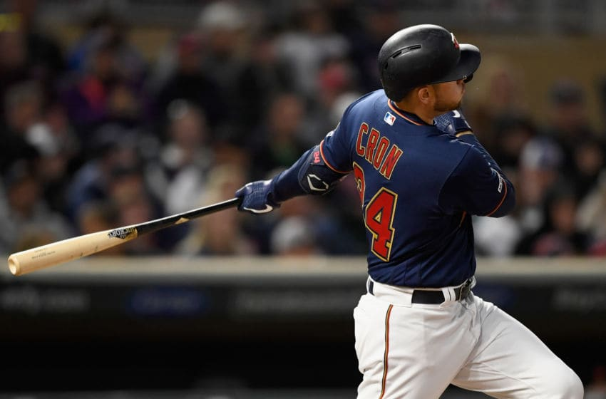 MINNEAPOLIS, MN - MAY 11: C.J. Cron #24 of the Minnesota Twins hits a three-run home run against the Detroit Tigers during the fifth inning of game two of a doubleheader on May 11, 2019 at Target Field in Minneapolis, Minnesota. The Twins defeated the Tigers 8-3. (Photo by Hannah Foslien/Getty Images)