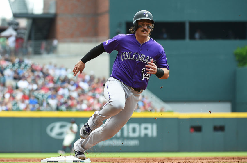 ATLANTA, GEORGIA - APRIL 28: Tony Wolters #14 of the Colorado Rockies rounds third base en route to scoring in the third inning against the Atlanta Braves at SunTrust Park on April 28, 2019 in Atlanta, Georgia. (Photo by Logan Riely/Getty Images)