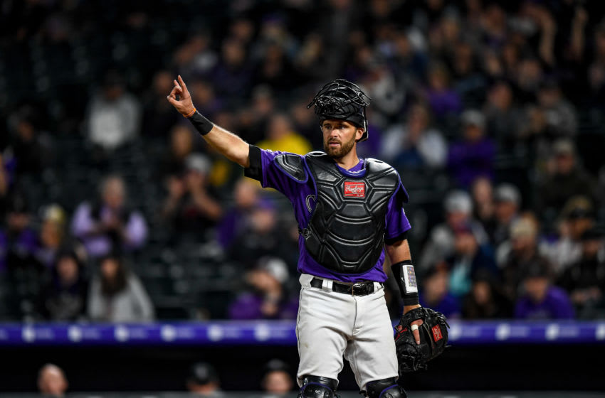 DENVER, CO - APRIL 23: Drew Butera #25 of the Colorado Rockies signals two outs during a game against the Washington Nationals at Coors Field on April 23, 2019 in Denver, Colorado. (Photo by Dustin Bradford/Getty Images)