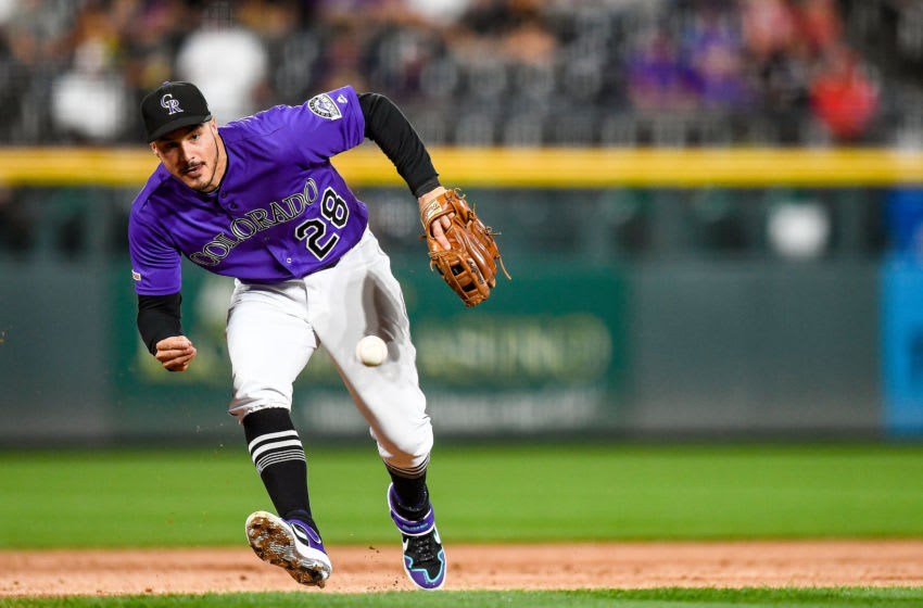 DENVER, CO - JULY 13: Nolan Arenado #28 of the Colorado Rockies reaches to make a barehanded defensive play in the first inning of a game against the Cincinnati Reds at Coors Field on July 13, 2019 in Denver, Colorado. (Photo by Dustin Bradford/Getty Images)
