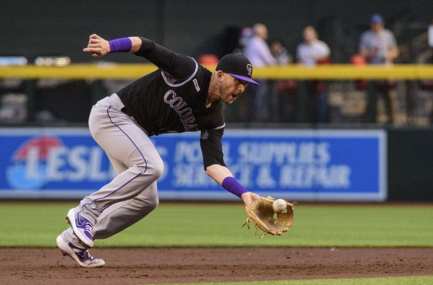 PHOENIX, ARIZONA - JUNE 18: Trevor Story #27 of the Colorado Rockies fields a ground ball in the first inning of a MLB game against the Arizona Diamondbacks at Chase Field on June 18, 2019 in Phoenix, Arizona. (Photo by Jennifer Stewart/Getty Images)