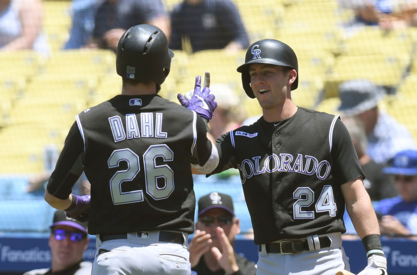 LOS ANGELES, CALIFORNIA - JUNE 23: David Dahl #26 of the Colorado Rockies celebrates his solo homerun with Ryan McMahon #24, to take a 1-0 lead over the Los Angeles Dodgers, during the first inning at Dodger Stadium on June 23, 2019 in Los Angeles, California. (Photo by Harry How/Getty Images)